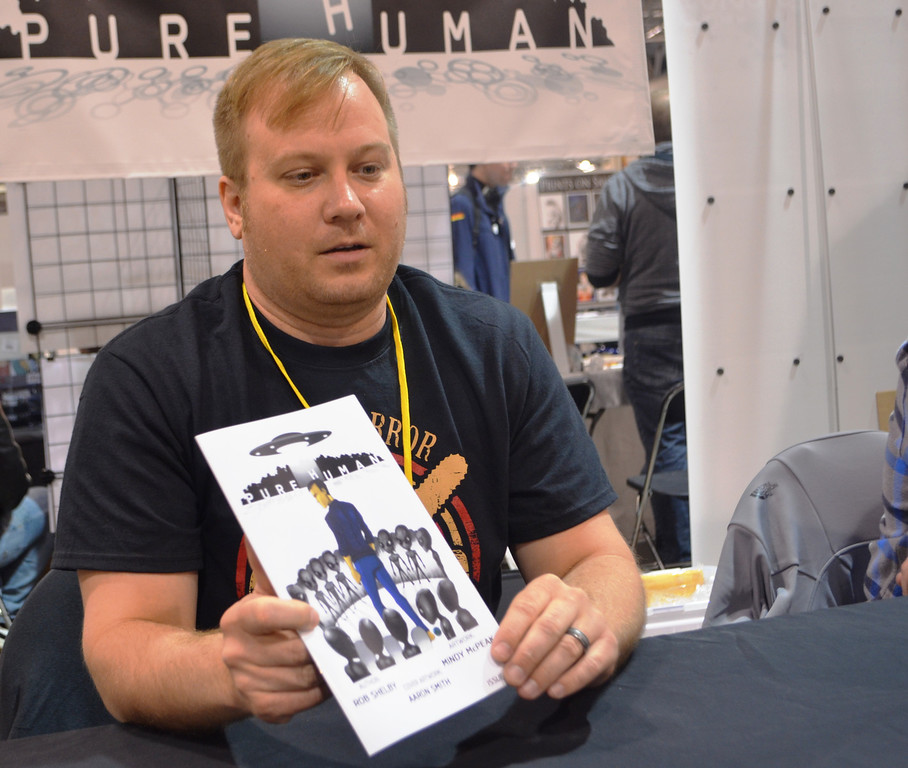 Description of . Rob Shelby, author of Pure Human. Images from Friday May 16 at the Motor City Comic Con in Novi, Michigan.  Photo by Dave Herndon.