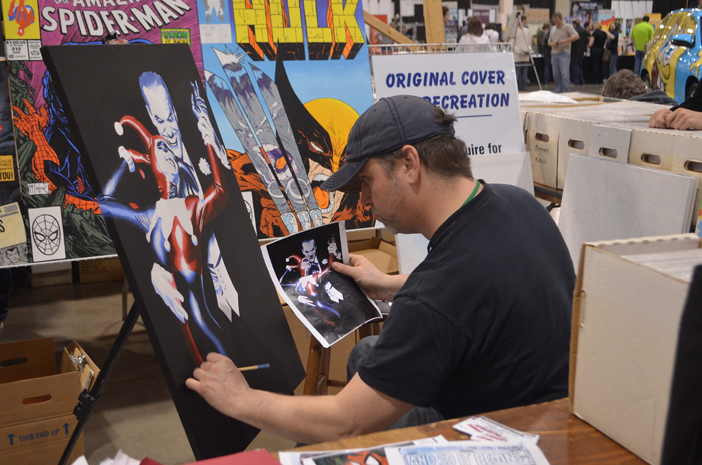 Description of . Mike Klingelsmith works on a cover recreation painting at the 25th annual Motor City Comic Con. Photo by Dave Herndon.