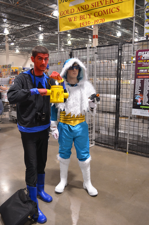 Description of . These two convention attendees dressed as their favorite villains, DC Comics characters Sinestro (left) and Captain Cold. In all, more than 20,000 people are expected to attend the convention in Novi before it wraps up this weekend. (Photo by Dave Herndon)