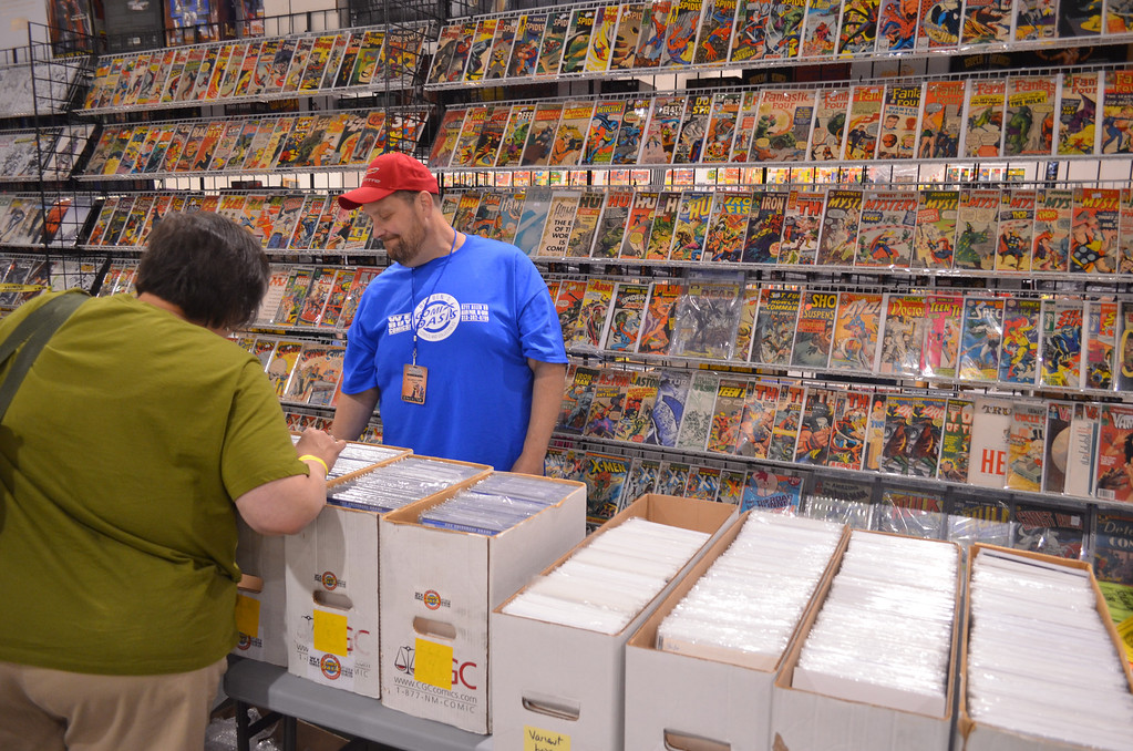 "Description of . Chatting with an early customer is John ""Big Ben"" Davis, owner of Big Ben's Comix Oasis in Allen Park. Big Ben's is the only comic shop from Downriver that participates in the Motor City Comic Con. (Photo by Dave Herndon)"