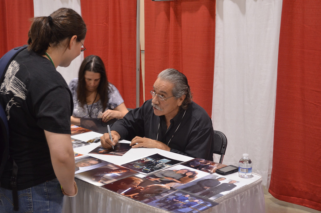 "Description of . Actor Edward James Olmos signs a photo for a fan Friday at the Motor City Comic Con in Novi. Olmos is best known for his role as Cmdr. William Adama on the rebooted ""Battlestar Galactica."" The convention will be at the Suburban Collection Showplace Saturday from 10 a.m. to 6 p.m. and Sunday from 10 a.m. to 5 p.m. (Photo by Dave Herndon)"