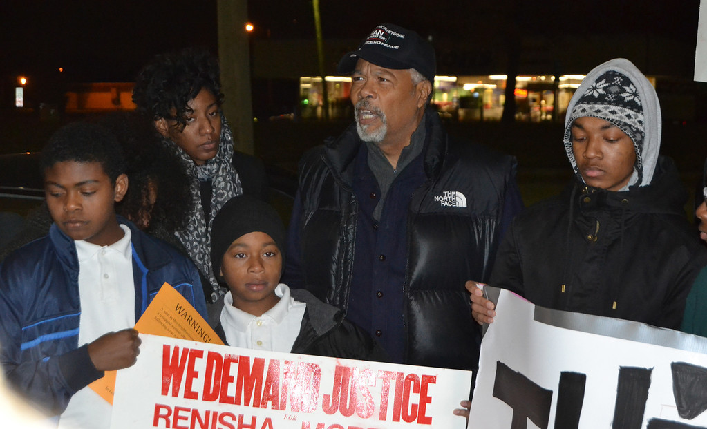 Description of . Sam Riddle of the National Action Network attended a protest to extend condolences to the community Thursday night.