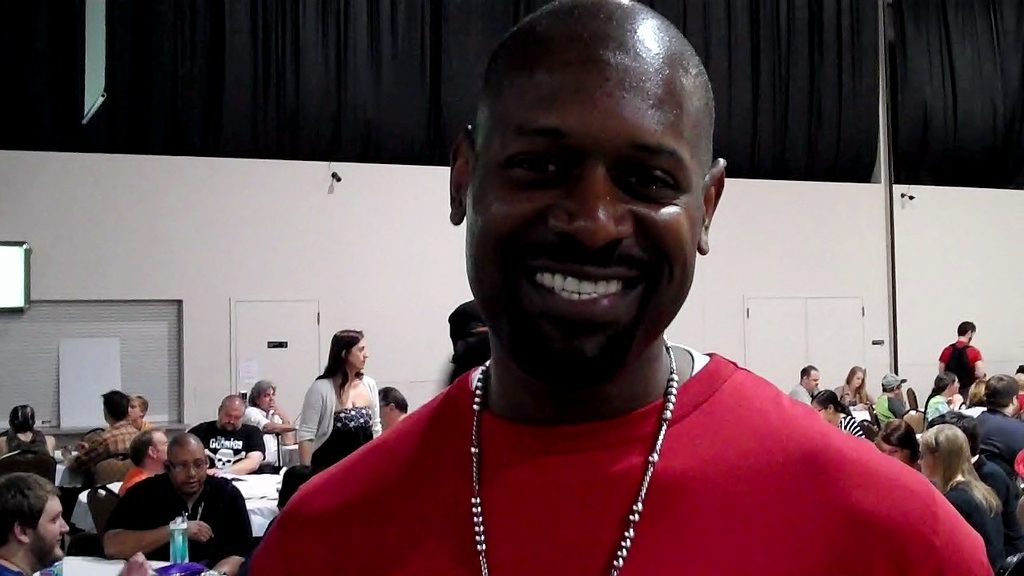 Description of . Detroit Lions great Herman Moore enjoyed the day at the Motor City Comic Con. Calling himself a big Star Wars and Battlestar Galactica fan, he also likes superheroes. Moore said he grew up reading comics. Photo by David Komer