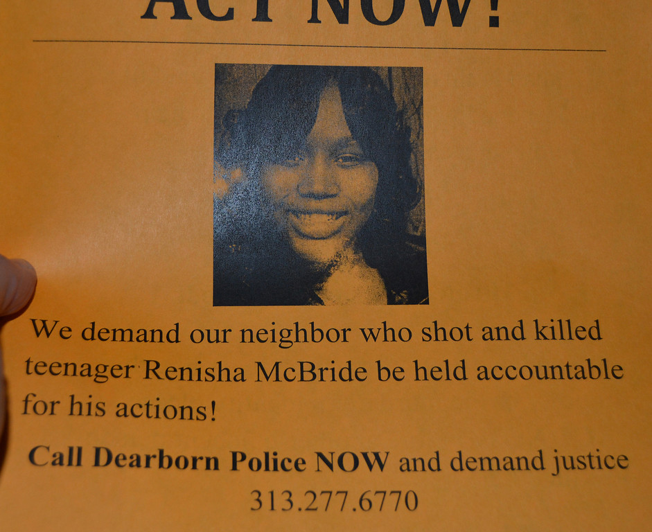 Description of . Fliers are passed out to participants in a protest Thursday evening, urging them to contact the Dearborn Heights Police Department and demand justice for Renisha McBride.