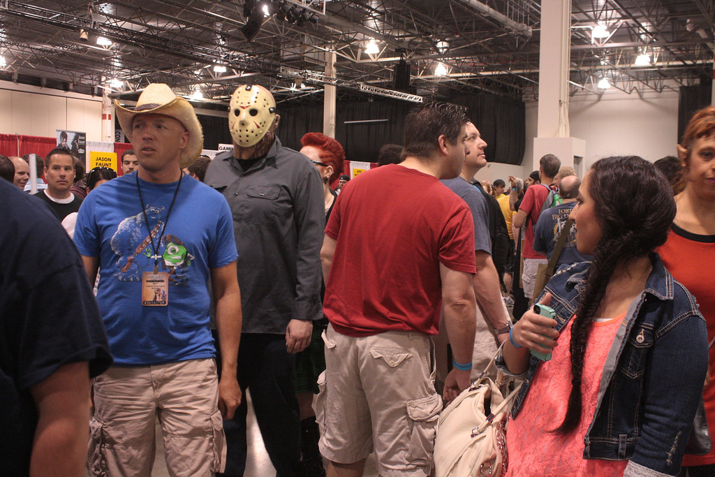 Description of . A man dressed as Jason Voorhees wends his way through the comic con crowd. (Photo by Erica McClain)