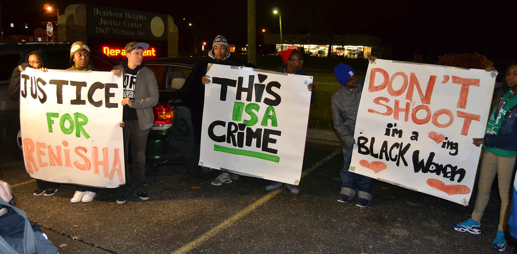 Description of . Teens created signs for the protest outside of the Dearborn Heights police station Thursday evening.