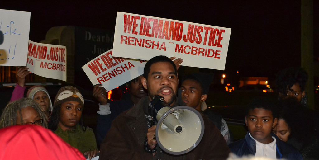 Description of . Dawud Walid, executive director of the Council on American-Islamic Relations-Michigan Chapter, speaks in front of dozens of residents who gathered at the Dearborn Heights police station for a protest Thursday night.