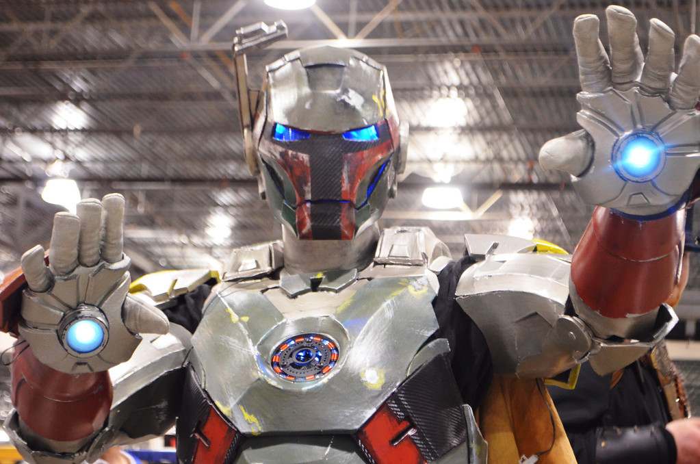 ". A man dressed as his own creation, the ""Iron Fett,\"" at the 2014 Motor City Comic Con. The character is a cross between Iron Man and Boba Fett. Photo by Dave Herndon."