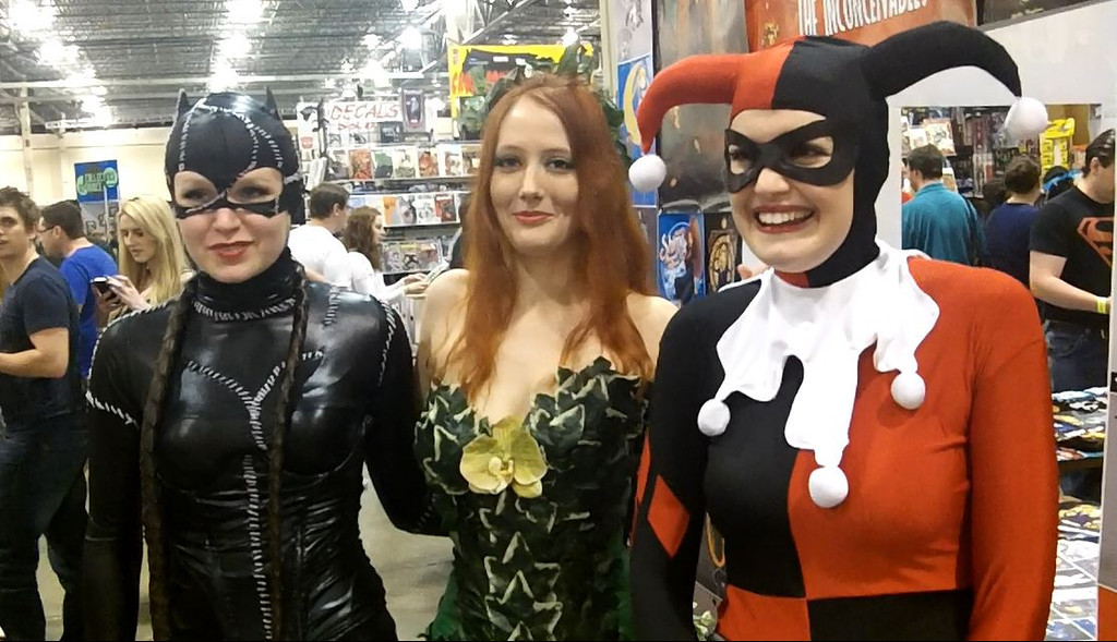. Kayla Mangles (left) Lorraine Schlechter and Cassie Mangles of Lansing dress as Catwoman, Poison Ivy and Harlequin. Photo by David Komer